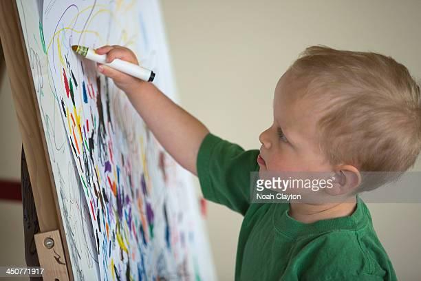 USA, Montana, Whitefish, Toddler drawing on wall