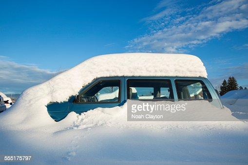 USA, Montana, Whitefish, View of snowcapped car