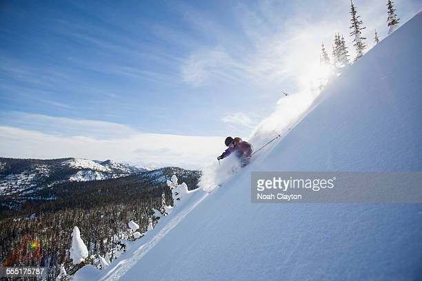 USA, Montana, Whitefish, View of young man skiing in snowcapped mountains