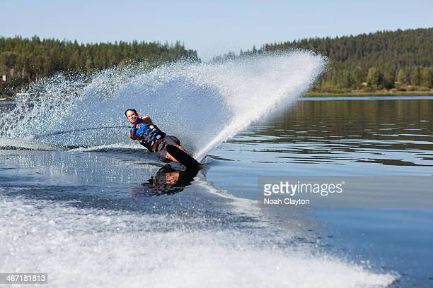 usa, montana, whitefish, whitefish lake, man waterskiing - waterskiing stock photos and pictures