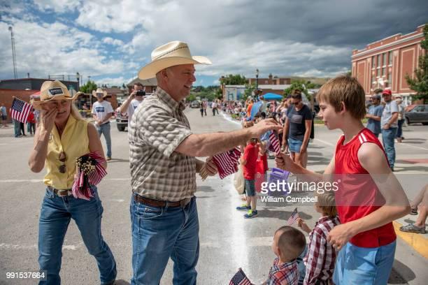 Montana's Republican Congressman Greg Gianforte campaigns at the Livingston Roundup Rodeo parade on July 2 2018 in Livingston Montana Gianforte will...