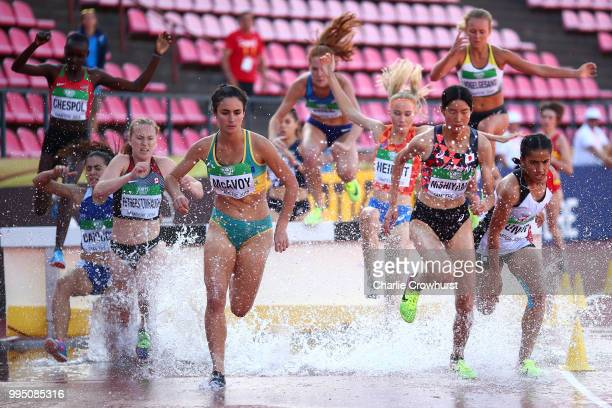 Montanna McAvoy of Australia and Manami Nishiyama of Japan lead the Women's 3000 metres steeplechase at the water jump on day one of The IAAF World...