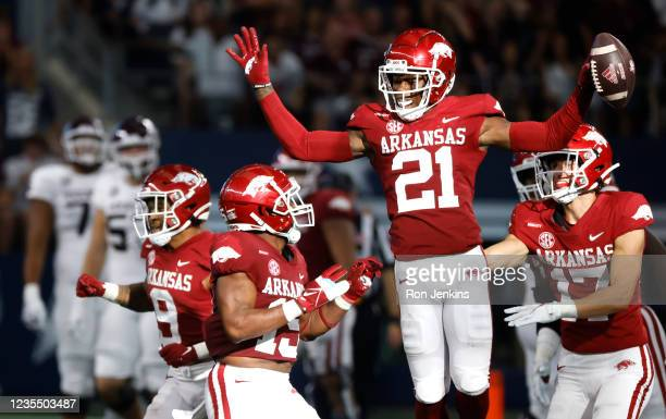 Montaric Brown of the Arkansas Razorbacks reacts after intercepting against the Texas A&M Aggies in the second half of the Southwest Classic at AT&T...