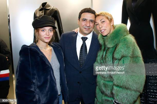 Montassar Alaya standing between Director of Public Relations for France at Dior Mathilde Favier and her daughter Heloise Agostinelli attend the...
