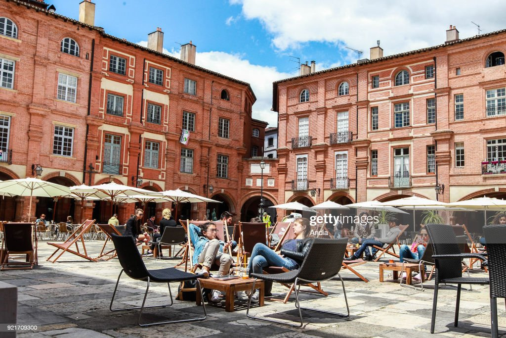 cafe terraces in 'Place Nationale' square.