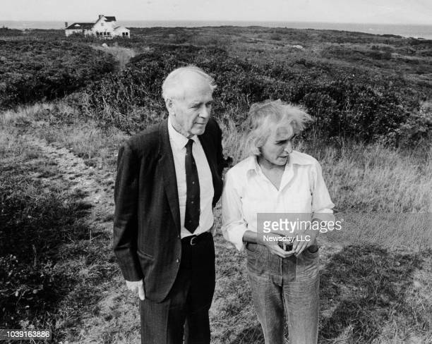 Pilot Charles A Lindbergh stands with his friend book editor and environmentalist Hilda Lindley near her home in Montauk New York on October 7 1973