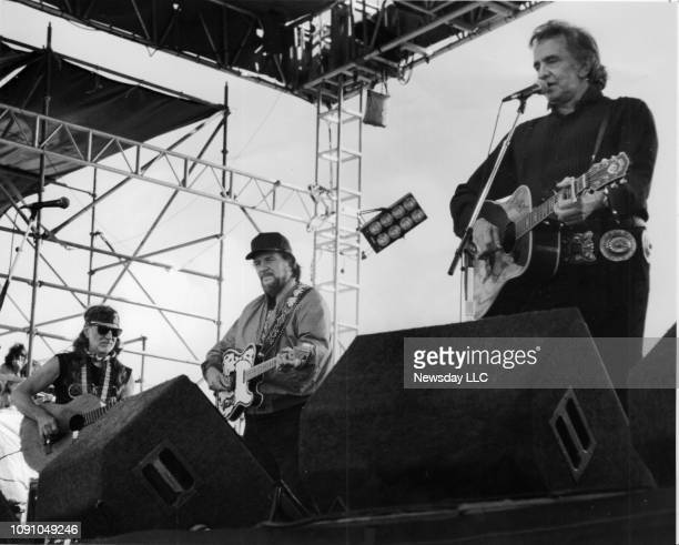 Willie Nelson , Waylon Jennings and Johnny Cash , perform at the Paul Simon benefit concert in Montauk on August 24, 1992. They are three out of the...