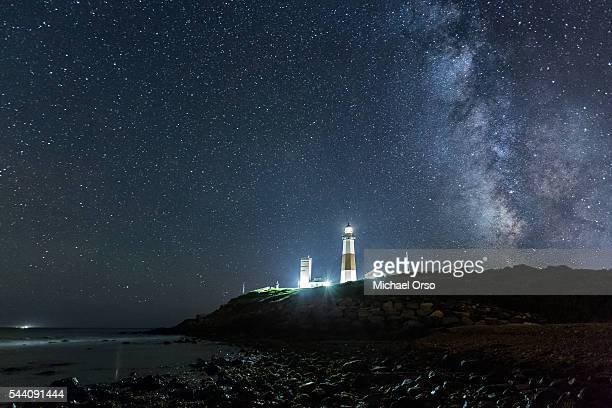 montauk point long island at night. beach, lighthouse, milky way galaxy. - long island stock pictures, royalty-free photos & images