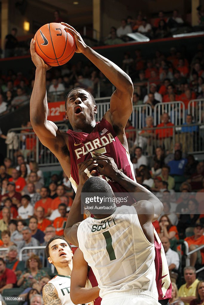 Montay Brandon #5 of the Florida State Seminoles draws an offensive foul when he runs into Durand Scott #1 of the Miami Hurricanes on January 27, 2013 at the BankUnited Center in Coral Gables, Florida. The Hurricanes defeated the Seminoles 71-47.