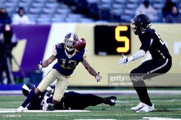 Montay Crockett of Atlanta Legends drops a pass under pressure from Elijah Campbell of Birmingham Iron during the third quarter of the Alliance of...