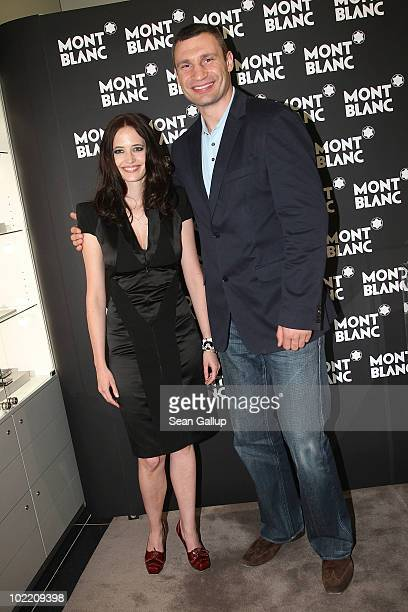 Montblanc brand ambassador Eva Green and boxer Vitali Klitschko attend the reception during the Montblanc White Nights Festival at Montblanc Boutique...