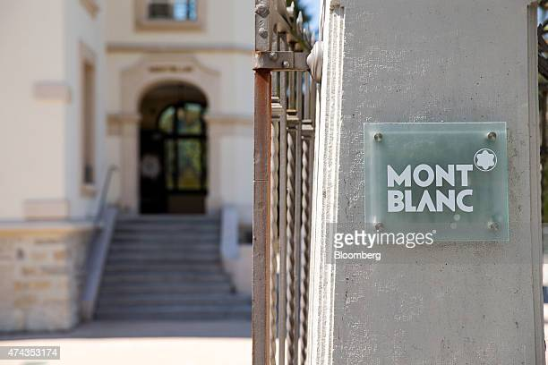A Montblanc logo sits in front the entrance to the Montblanc luxury watch factory in Le Locle Switzerland on Monday May 18 2015 Montblanc owned by...