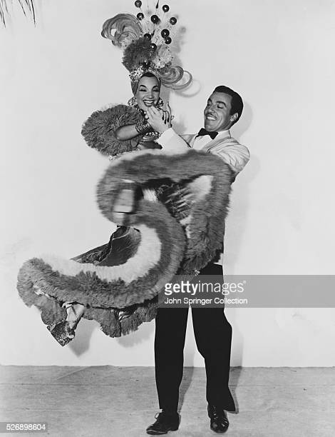 Monte Blanca lifts Rosita Rivas into the air as they dance in a publicity still for WeekEnd in Havana