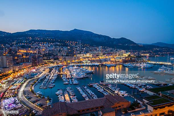 monte carlo bay blue hour monaco - monte carlo stock pictures, royalty-free photos & images