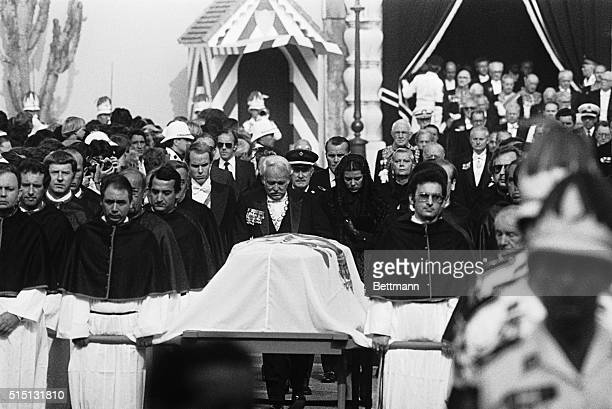 A sadfaced Prince Rainer III of Monaco and two of his three children Princess Caroline and Prince Albert follow the coffin of Princess Grace during...