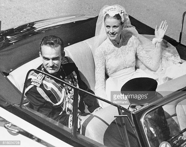 Grace Kelly in open car waving to admirers while returning to the palace after the religious wedding with Prince Rainier April 20 1956