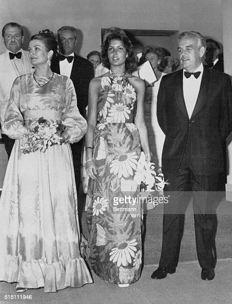 With Prince Rainier of Monaco radiant Princess Grace and her daughter Princess Caroline both wearing Christian Dior gowns arrive to the Monte Carlo...