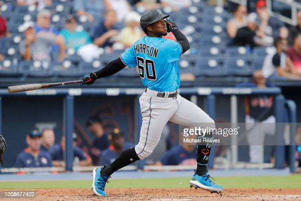 Monte Harrison of the Miami Marlins at bat against the Houston Astros during a Grapefruit League spring training game at FITTEAM Ballpark of The Palm...
