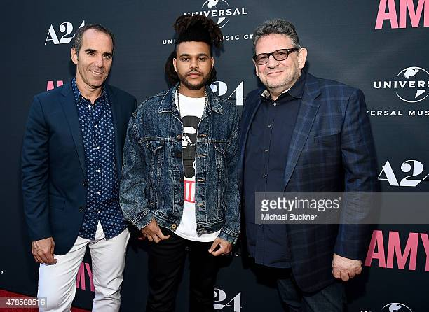 Monte Lipman Chairman CEO Republic Records musician The Weeknd and Lucian Grainge Chairman CEO of Universal Music Group arrive at the premiere of A24...
