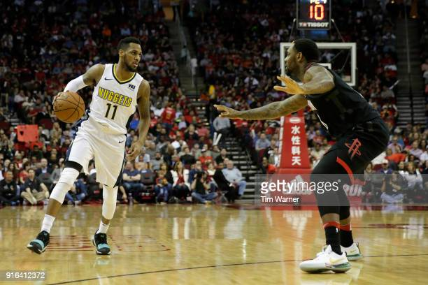 Monte Morris of the Denver Nuggets brings the ball down the court defended by Tarik Black of the Houston Rockets in the second half at Toyota Center...