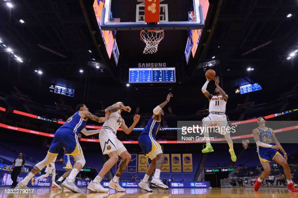 Monte Morris of the Denver Nuggets drives to the basket during the game against the Golden State Warriors on April 12, 2021 at Chase Center in San...