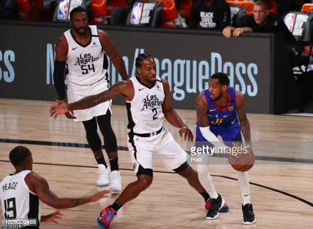 Monte Morris of the Denver Nuggets is guarded by Kawhi Leonard of the LA Clippers in the first quarter at AdventHealth Arena at ESPN Wide World Of...