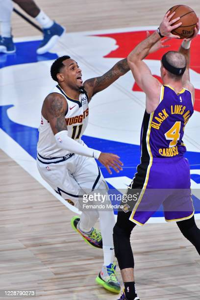 Monte Morris of the Denver Nuggets plays defense against Alex Caruso of the Los Angeles Lakers during Game Five of the Western Conference Finals of...