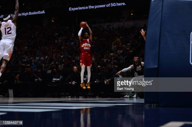 Monte Morris of the Denver Nuggets shoots a three point basket against the Phoenix Suns during Round 2, Game 4 of the 2021 NBA Playoffs on June 13,...