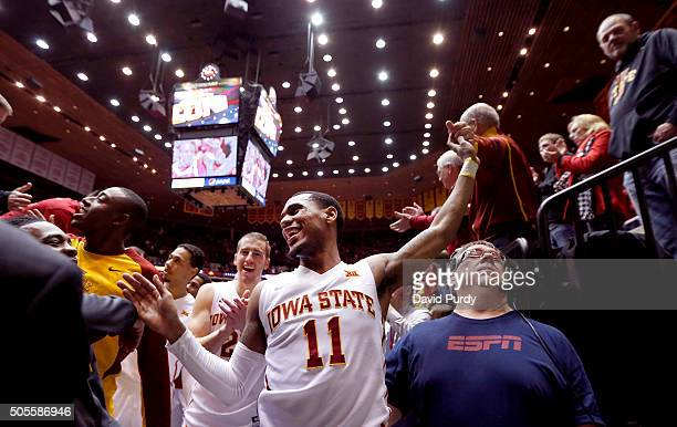 Monte Morris of the Iowa State Cyclones celebrates with fans and teammate Matt Thomas of the Iowa State Cyclones after Iowa State defeated the...