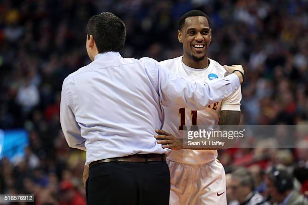 Monte Morris of the Iowa State Cyclones celebrates with head coach Steve Prohm in the second half against the Arkansas Little Rock Trojans during the...