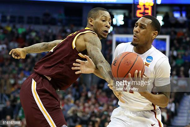 Monte Morris of the Iowa State Cyclones fights for a ball with Isaiah Williams of the Iona Gaels during the first round of the 2016 NCAA Men's...