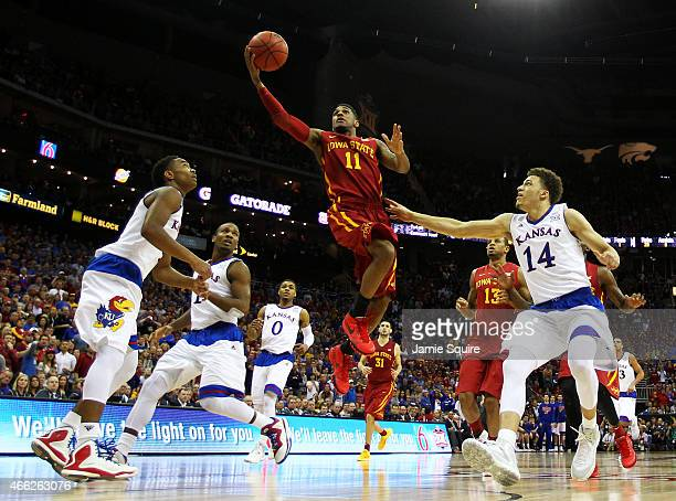 Monte Morris of the Iowa State Cyclones goes up against the Kansas Jayhawks in the second half during the championship game of the Big 12 Basketball...