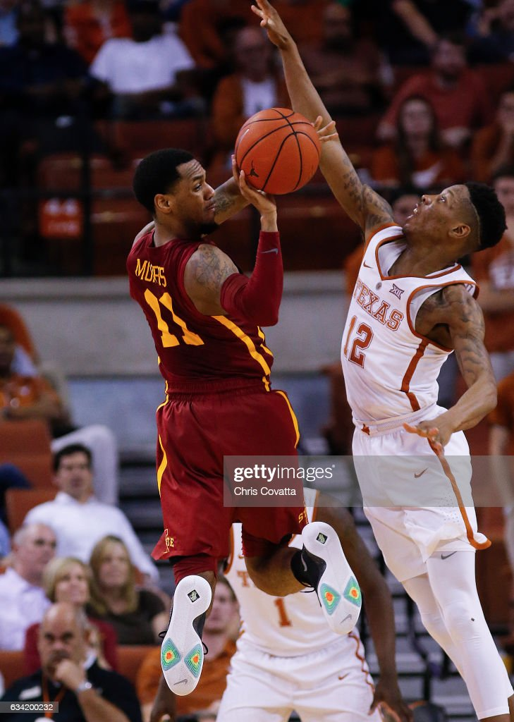 Monte Morris #11 of the Iowa State Cyclones passes around Kerwin Roach Jr. #12 of the Texas Longhorns at the Frank Erwin Center on February 7, 2017 in Austin, Texas.