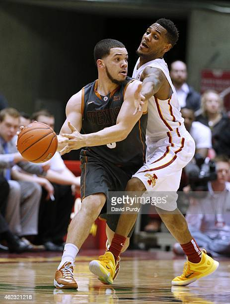 Monte Morris of the Iowa State Cyclones puts pressure on Javan Felix of the Texas Longhorns in the first half of play at Hilton Coliseum on January...