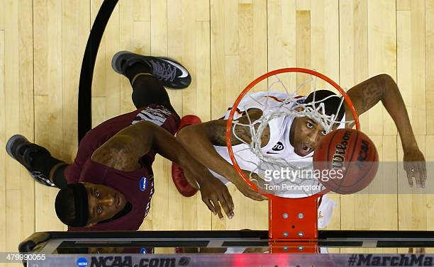 Monte Morris of the Iowa State Cyclones puts up a shot against Ebuka Anyaorah of the North Carolina Central Eagles during the second round of the...