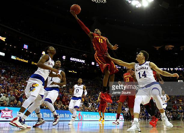 Monte Morris of the Iowa State Cyclones shoots over Brannen Greene of the Kansas Jayhawks in the second half during the championship game of the Big...