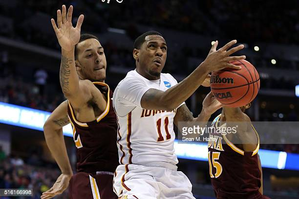 Monte Morris of the Iowa State Cyclones shoots the ball between Taylor Bessick and Deyshonee Much of the Iona Gaels during the first round of the...