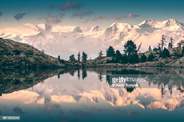 monte rosa reflected in alpine lake - monte rosa foto e immagini stock