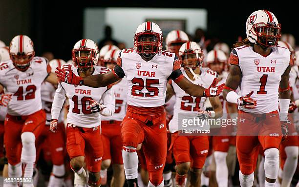 Monte Seabrook of the Utah Utes runs onto the field with his Utah teammates before the start of a college football game against the Arizona State Sun...