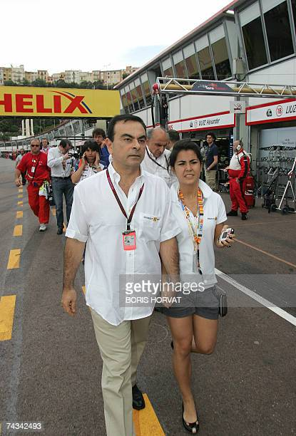 Reanult CEO Carlos Ghosn and his wife Rita walk in the pits of the Monaco racetrack 27 May 2007 in Monte Carlo before the Monaco Formula One Grand...