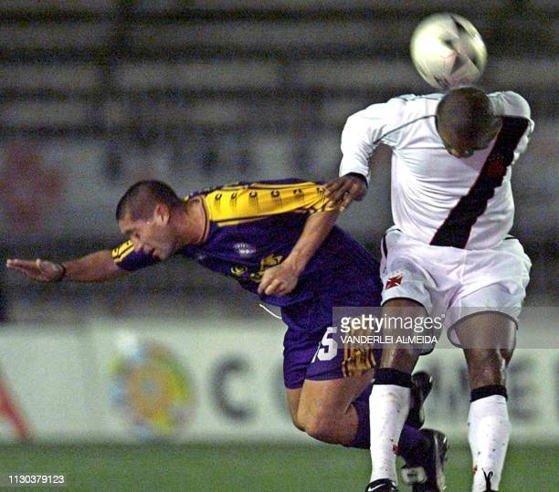 Montecinos of Deportivo Concepcion de Chile fights for the ball with Geder defenseman for Vasco da Gama 16 May 2001 in Rio de Janeiro Brazil El...