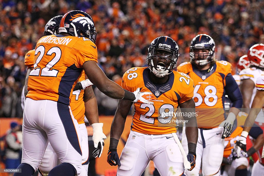 Montee Ball #28 of the Denver Broncos celebrates scoring a second quarter touchdown with C.J. Anderson and Orlando Franklin #74 against the Kansas City Chiefs at Sports Authority Field at Mile High on November 17, 2013 in Denver, Colorado.