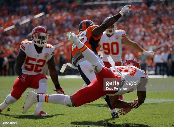 Montee Ball of the Denver Broncos eludes the tackle of cornerback Chris Owens of the Kansas City Chiefs before facing linebacker JamesMichael Johnson...