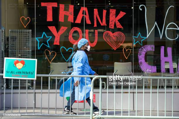 Montefiore Medical Center employee walks past signs thanking the medical staff on April 9 2020 in New York City New York Governor Andrew Cuomo said...