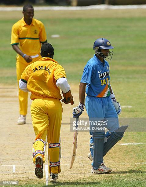 Indian captain Rahul Dravid leaves the field as Jamaican bowler Andrew Richardson celebrates with wicketkeeper Keith Hibbert his dismissal for LBW...