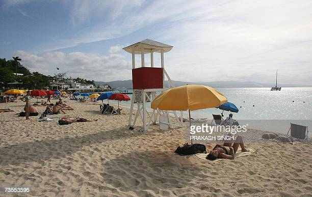 This picture taken on 10 March 2007 shows tourists sunbathing at Doctor Cave beach in Montego BayJamaica Jamaica is the third largest island in the...