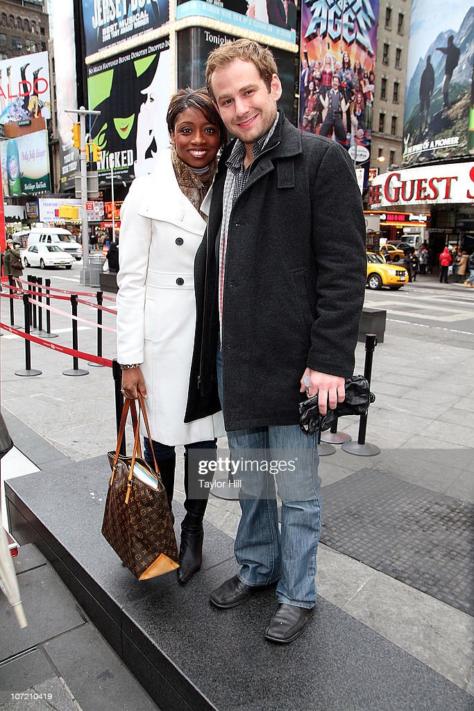 Montego Glover and Chad Kimball attend the Stand Up to Cancer Times Square News Year's Eve initiative launch at Duffy Square on November 30, 2010 in New York City.
