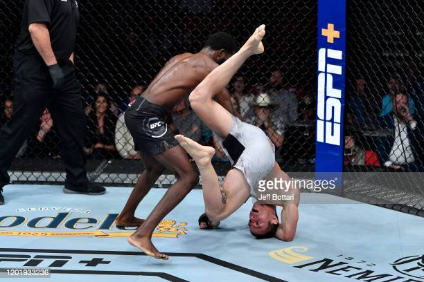 Montel Jackson takes down Felipe Colares of Brazil in their bantamweight bout during the UFC Fight Night event at PNC Arena on January 25 2020 in...