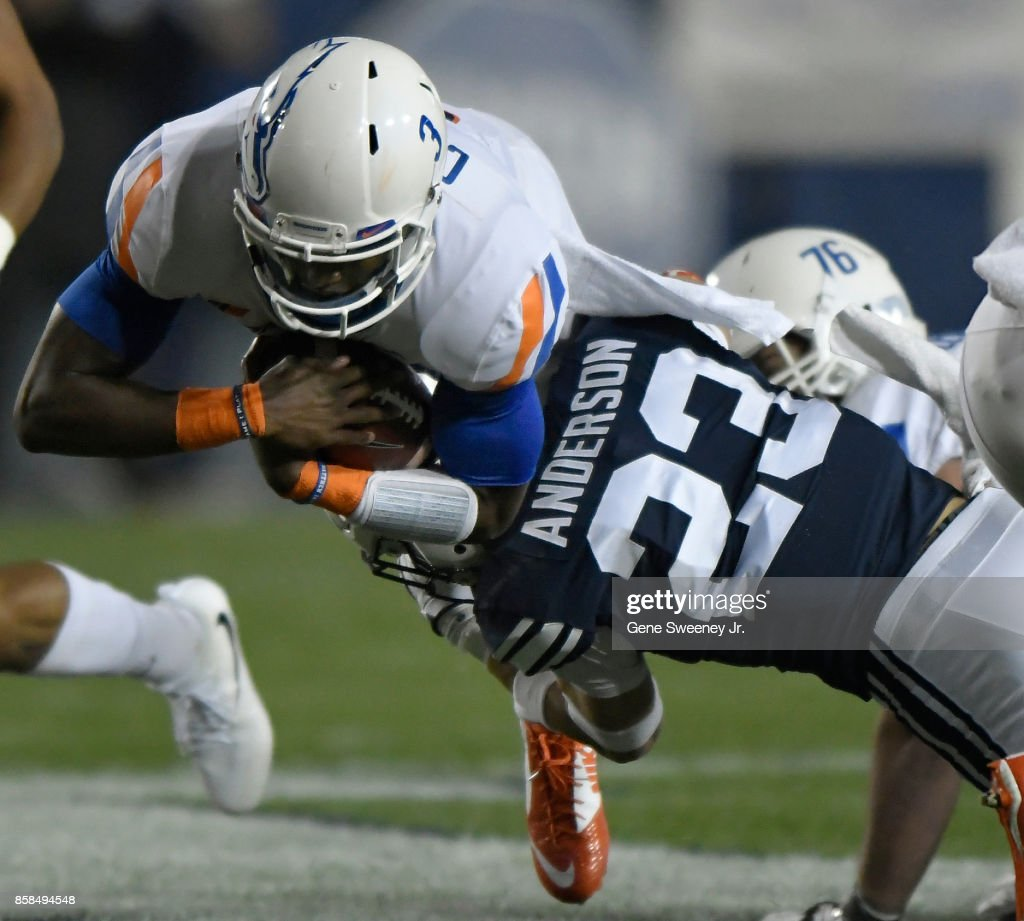 Montell Cozart #3 of the Boise State Broncos is tackled in the first half by Zayne Anderson #23 of the Brigham Young Cougars during their game at LaVell Edwards Stadium on October 6, 2017 in Provo, Utah.