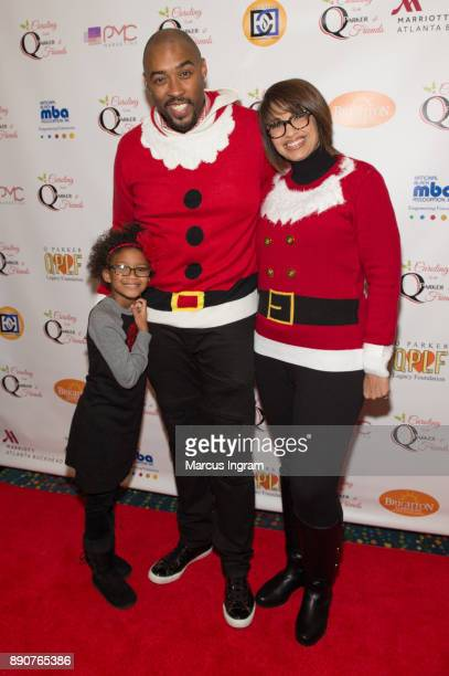 Montell Jordan wife Kristin Hudson and daughter attend the '5th Annual Caroling with Q Parker and Friends' at Atlanta Marriott Buckhead on December...